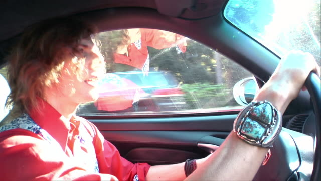close-up one young man driving car - teil einer serie stock-videos und b-roll-filmmaterial