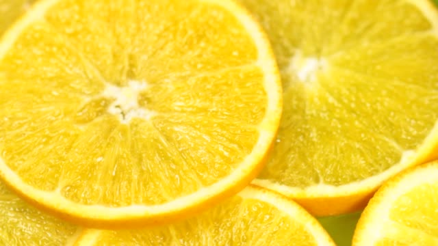close-up orange slices - lemon stock videos & royalty-free footage