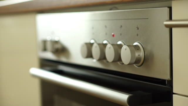 closeup oven in modern kitchen - oven stock videos & royalty-free footage