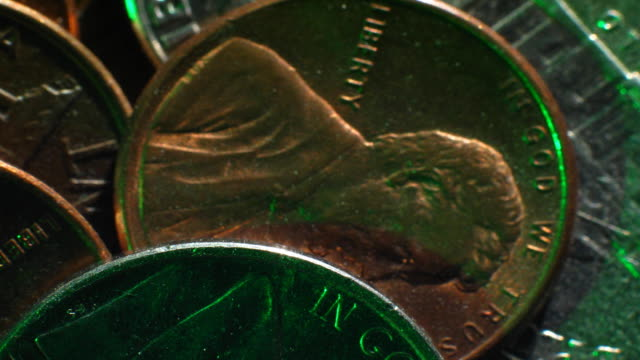 a close-up pan across loose american coins. - dime stock videos and b-roll footage