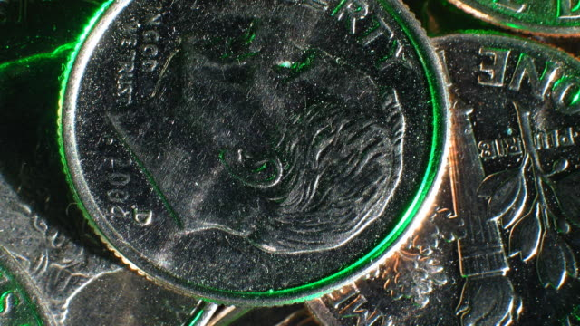 a close-up pan across loose american dimes. - dime stock videos and b-roll footage