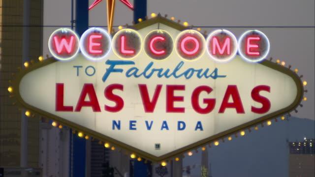 Close-up pan Fabulous Las Vegas Nevada sign flashing at dusk/ Las Vegas, Nevada, USA