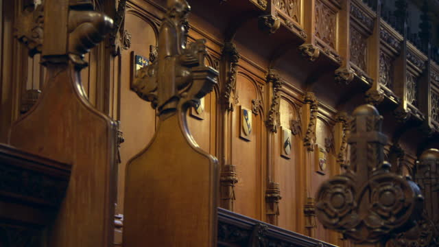 close-up pan of wood carvings and woodwork inside glasgow cathedral - carving craft product stock videos & royalty-free footage