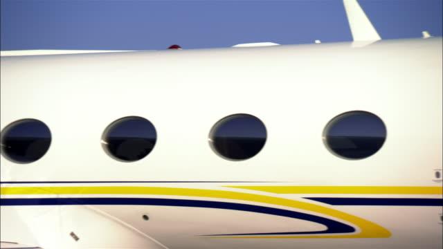 close-up pan private jet at airport / long beach, california, usa - airport runway stock videos & royalty-free footage