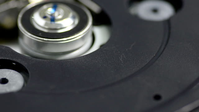 close-up panning: inside of cd-rom drive - dvd player stock videos & royalty-free footage