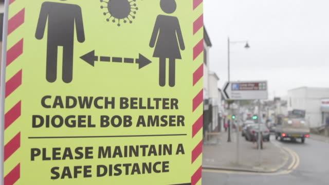 "closeup panning shot of a coronavirus social distancing warning sign in caerphilly - ""bbc news"" stock videos & royalty-free footage"