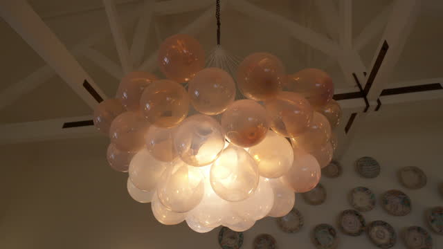 close-up panning shot of illuminated hanging lights in hotel - porto, portugal - electric lamp stock videos & royalty-free footage