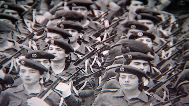 close-up pan-right across a photograph of the druze popular liberation army in 1976. - basco video stock e b–roll