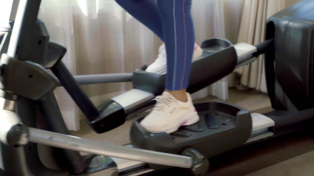 closeup part of body young woman exercise working out and jogging on a treadmill in the gym. - treadmill stock videos & royalty-free footage