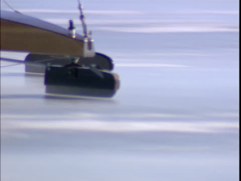 1999 close-up part of ice yacht sliding across frozen st. lawrence river/ montreal, quebec, canada - sankt lorenz strom stock-videos und b-roll-filmmaterial