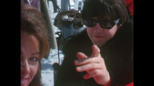 Closeup Paul talking to an unidentified young woman / 8mm amateur home movie footage filmed by the actor Leo McKern and featuring the Beatles making...