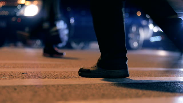 close-up people crossing street at night - human foot stock videos and b-roll footage