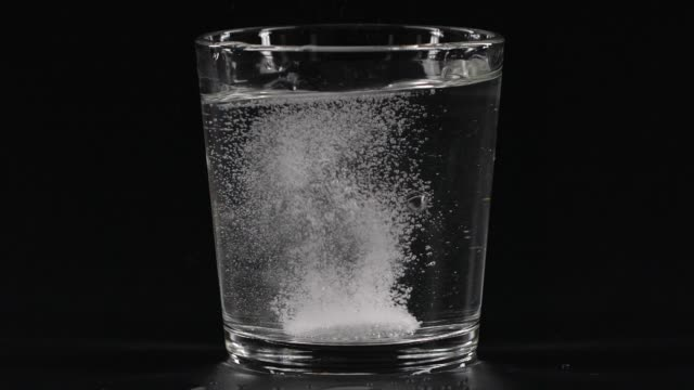 close-up pill in glass of water - ascorbic acid stock videos & royalty-free footage