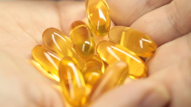 close-up pills - omega 3 stock videos & royalty-free footage