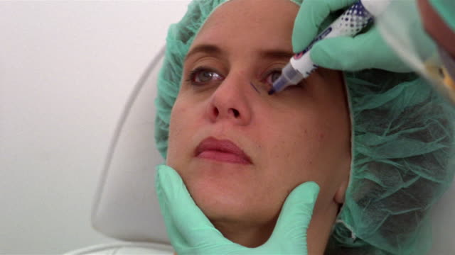 close-up plastic surgeon drawing dotted lines around woman's eyes/ panama city, panama  - plastic surgery stock videos and b-roll footage
