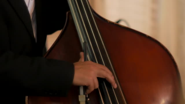 Close-up :Playing on cello in the orchestra