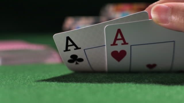 close-up poker player showing good card combination - pair stock videos & royalty-free footage