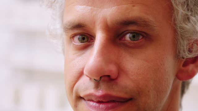 close-up portrait of a mid adult man - nose piercing stock videos & royalty-free footage