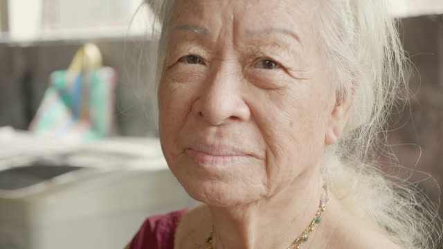 close-up portrait of a senior asian woman - winking stock videos & royalty-free footage