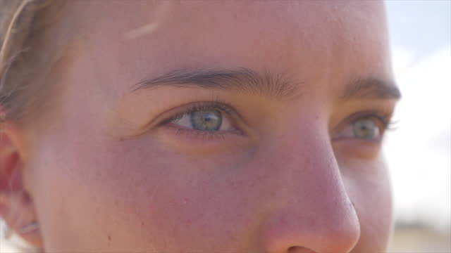 close-up portrait of a woman eyes on a beach. - slow motion - challenge stock videos & royalty-free footage