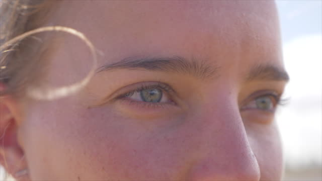 close-up portrait of a woman eyes on a beach. - vitality stock videos & royalty-free footage