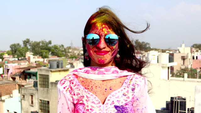 close-up portrait of a young indian women celebrating holi festival - religion stock videos & royalty-free footage
