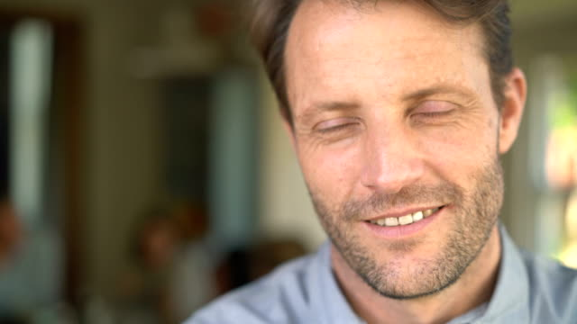close-up portrait of mature man smiling at home - blue eyes stock videos and b-roll footage