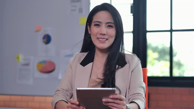 close-up portrait of smile asian businesswoman age 39 yearold looking at camera of confidence at modern office.waist up and close-up portraits concept. - video portrait stock videos & royalty-free footage
