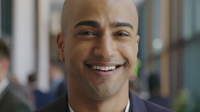 close-up portrait of smiling bald businessman - selective focus stock videos & royalty-free footage