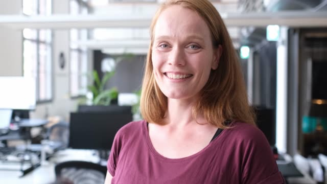 close-up portrait of smiling female entrepreneur - redhead stock videos & royalty-free footage