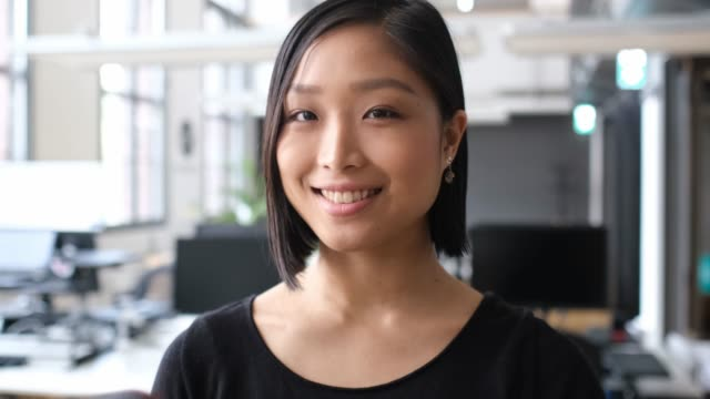 close-up portrait of smiling female professional - asian stock videos & royalty-free footage