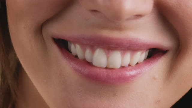 close-up portrait of smiling young woman - body care stock videos & royalty-free footage