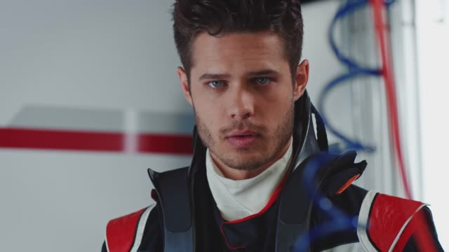 close-up portrait of young racer in race suit - grand prix motor racing stock videos & royalty-free footage