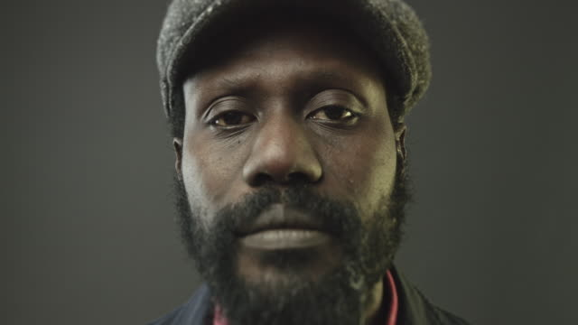 close-up portrait video of african man looking at camera - toned image stock videos and b-roll footage