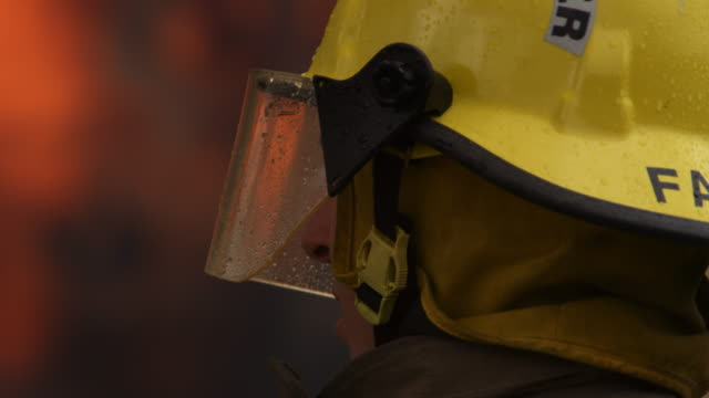 close-up profile of fireman fighting a fire - myrtle creek stock videos and b-roll footage