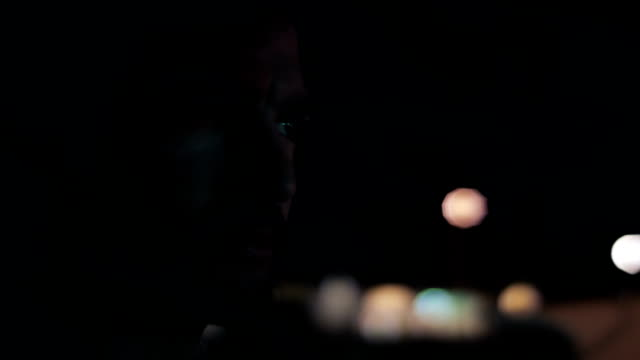 closeup profile of man driving at night - profile stock-videos und b-roll-filmmaterial