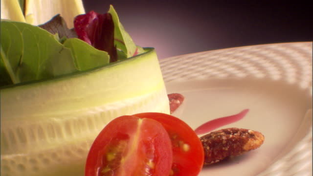 close-up push in of a rotating plate with a cucumber salad. - push in stock videos & royalty-free footage