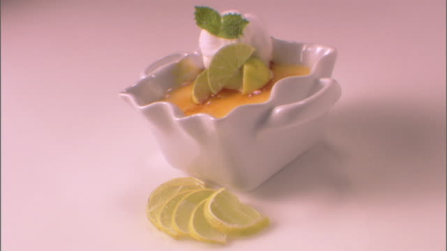 close-up push in over a creme brulee dessert on a white tabletop. - push in stock videos & royalty-free footage
