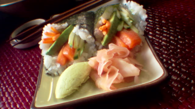 close-up push in over a plate cone sushi. - wasabi sauce stock videos and b-roll footage