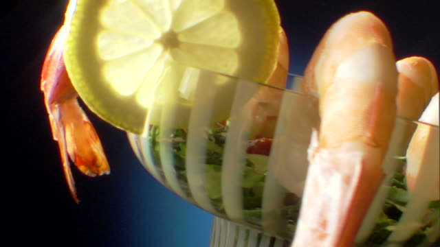 close-up push in to rotating shrimp cocktail. - push in stock videos & royalty-free footage