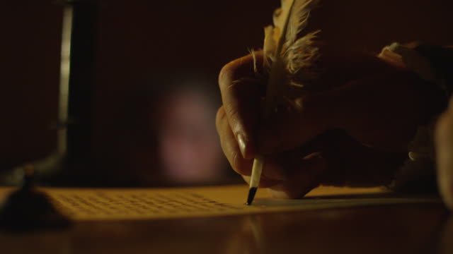 close-up reenactment of a man writing with quill pen in colonial america - 17th century stock videos & royalty-free footage
