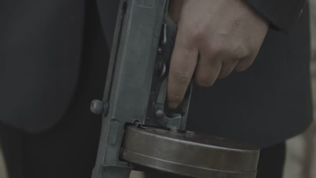 close-up reenactment shot of a gangster racking the slide of a thompson m1921 during prohibition - organised crime stock videos & royalty-free footage