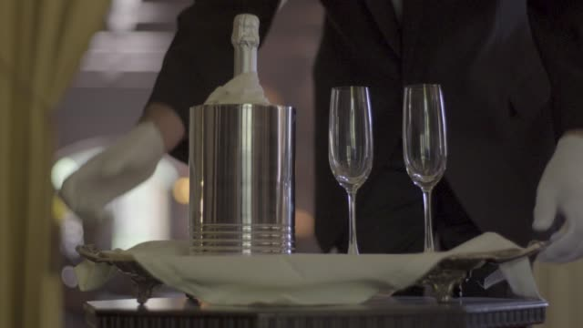 close-up shot of a waiter serving champagne - silver platter stock videos and b-roll footage