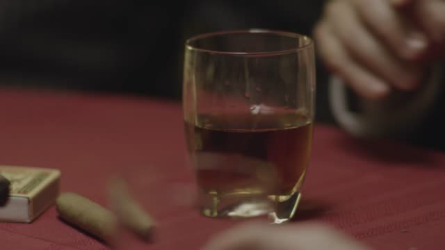 close-up reenactment shot of gangsters having whiskey at a table during prohibition - organized crime stock videos & royalty-free footage