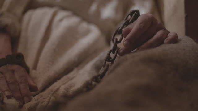 close-up shot of handcuffed hand of a 17th century dressed woman - women prison stock videos & royalty-free footage