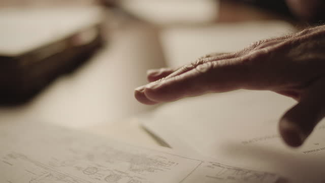 close-up shot of the hand of a man checking and discussing documents - talking politics stock videos & royalty-free footage