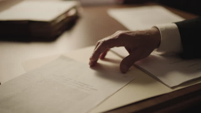close-up reenactment shot of the hand of a man checking documents during the 1980s - document stock videos & royalty-free footage