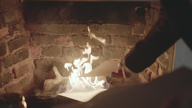 close-up shot of the hand of a man throwing letters to the fire - gossip stock videos & royalty-free footage