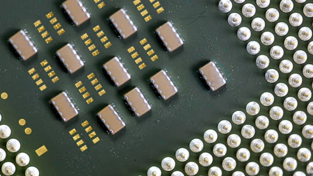close-up rotation:  many tiny chips on an old CPU