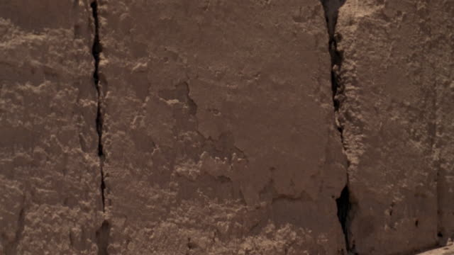 1999 close-up ruins of ancient adobe wall remaining in iranian desert/ bam, kerman province, iran - adobe material stock videos and b-roll footage